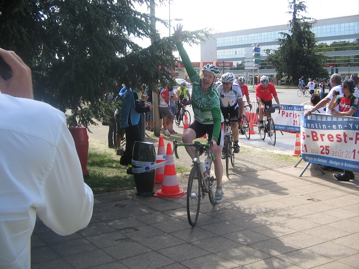 John O'Sullivan crosses the finish line